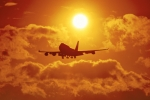 Dramatic evocative picture of Boeing 747 Jumbo jet aircraft coming in to land at Heathrow against red sunset