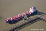 Aerial Photography Merchant Ship Vessel At Tunnel Wharf Jetty Thurrock London England