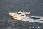 High Life motor cruiser boat in evening light cruising on Southampton water, England UK