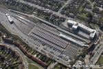 High level oblique aerial view east of Stanmore underground station with jubilee line trains, London HA7 England UK