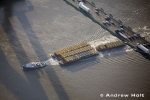 Aerial Photography Tug Boat And Container Barge On River Thames With Queen Elizabeth Ii Bridge Dartford London